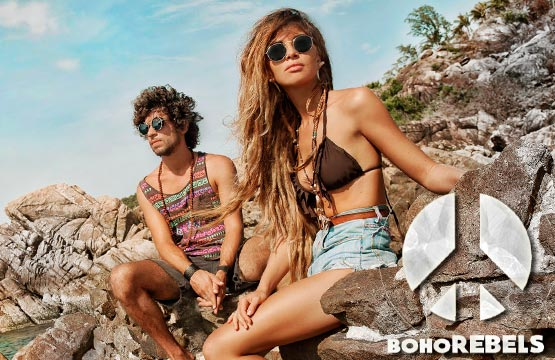Young boho couple on holiday in sun